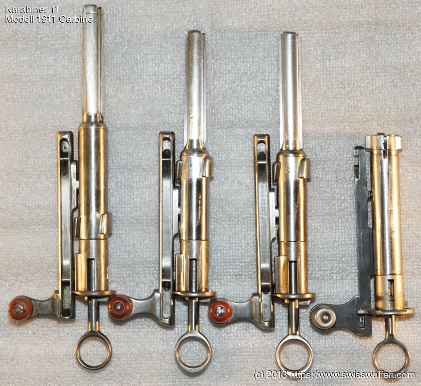 From left to right: 1. Bolt Modell 1889 Infantry Rifle 2. Bolt Modell 1897 Cadet Rifle (same as 3.) 3. Bolt Infanteriegewehre 89/96, 96/11, 11 and Karabiner/Kurzgewehre 00, 05, 00/11, 11 4. Bolt Modell 1931 Carbine, Modell 1931/42 Sniper Carbine, Modell 1931/43 Sniper Carbine